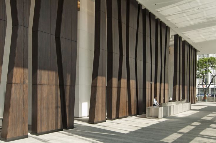 Enter to some sort of architectural feature and walk through it to reception.  Zuellig Building / SOM
