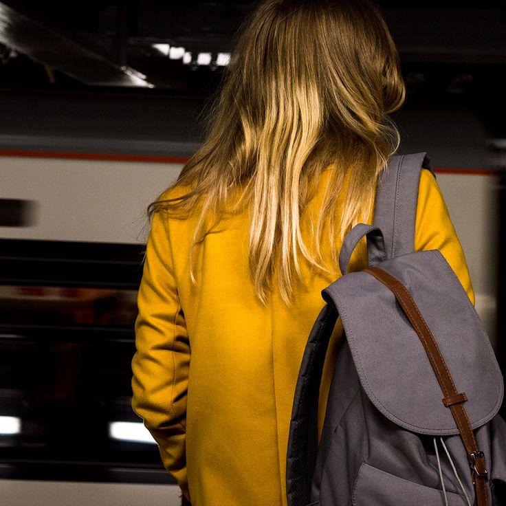 yellow subarine #london #underground #tube #tubestation #metro #girl #longhair #blonde #coat #yellowcoat #mindthegap #rushhour #hershel #bagpack