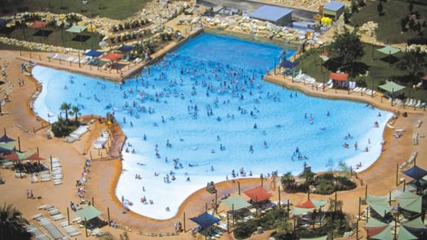 After a long day of riding roller coasters, cool off Texas-style in Six Flags Fiesta Texas' Lone Star Lagoon.