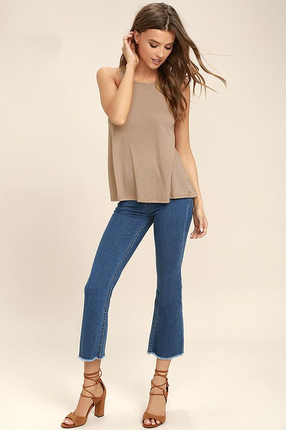 The Free People LA Nite Light Brown Tank Top is the perfect layering piece! Burnout ribbed stretch knit travels from a rounded neckline, into a deep sleeveless cut, with a racerback and flaring bodice.
