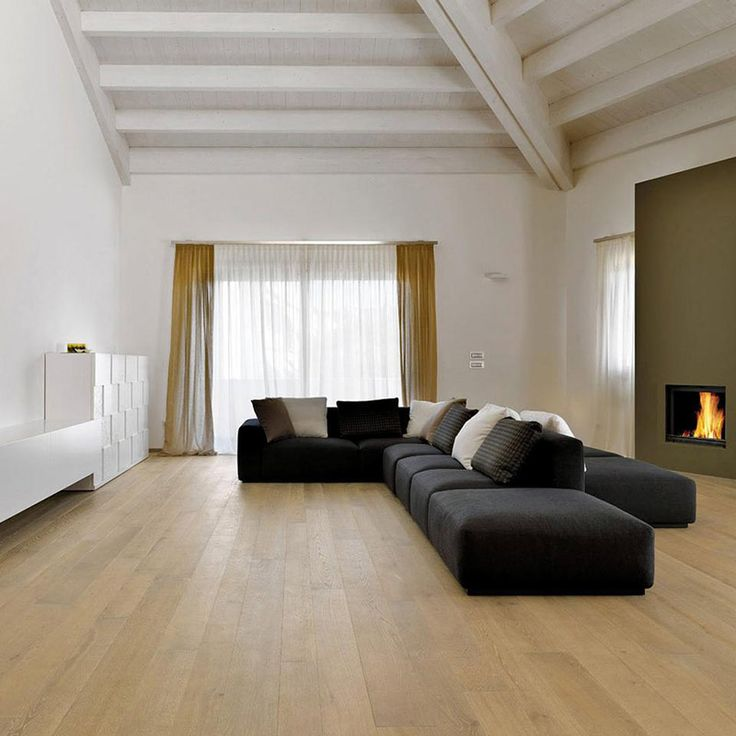Living room with fireplace in Sottomarina (Venice)  #Italy #italian #style #decoration #interiordesign #living #furniture #minimal #house #home #fireplace #modern #sofa #design #roof #fireplace #light #Venice