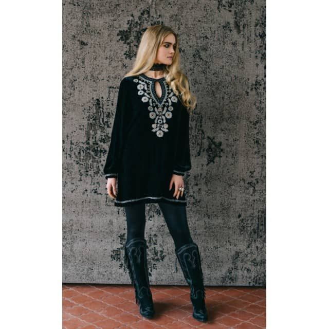 """This Double D Ranch Fall 2016 Amor Eterno Tunic is the definition of ethereal!! Soft velvet is the perfect background for cool toned floral embroidery and bronze studs that are the focal point of the neckline. Featuring an eye and hook closure for the optional key hole look. This stunning tunic looks great with jeans or leggings for a complete look! Timeless and exquisite, this tunic is a Fall wardrobe must have!! The bust on the XS measures approx. 38"""" and approx. 32"""" long."""