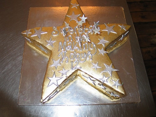 Star Shaped Cake Iced In Gold Chocolate Ganache Decorated