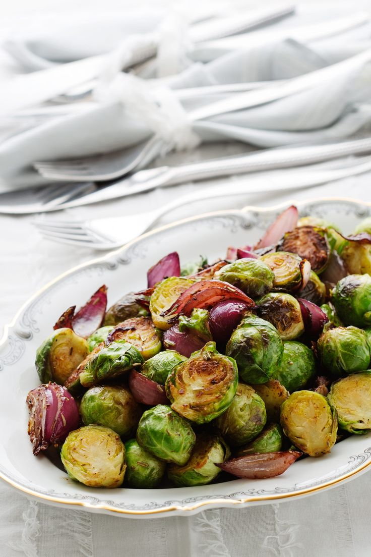 Tender Brussels sprouts fried in butter and served with caramelized red onions is a wonderful side dish that brings both flavor and color to your holiday dinner table. Whether you're preparing turkey, ham or a roast for the holidays, this dish will complement it perfectly.