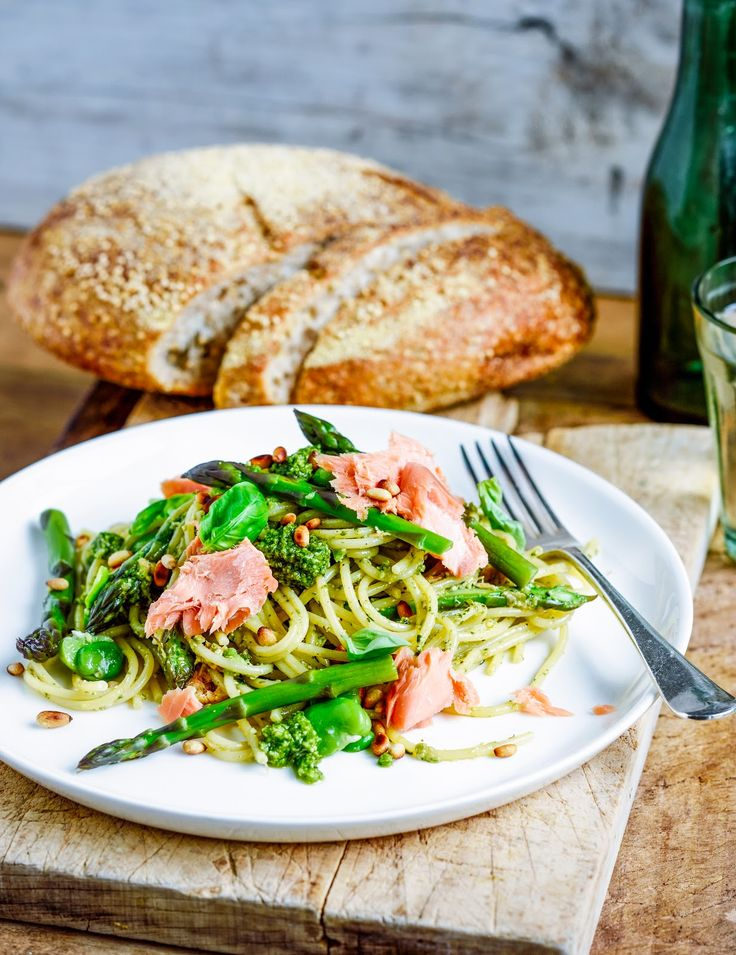 Summer spaghetti with broad beans, asparagus, pesto and hot smoked salmon