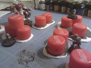 Barrels made from bottle caps. Infinity - How much terrain do you need? | Warhammer 40k, Fantasy, Wargames & Miniatures News: Bell of Lost Souls