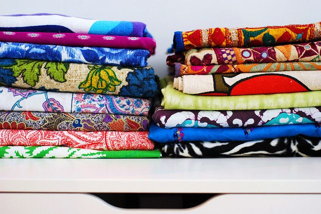 Stacks of fabric in home office