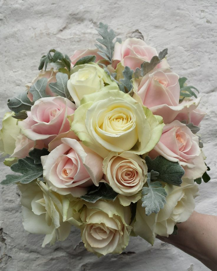 Avalanche and sweet avalanche roses with senecio foliage. So soft.