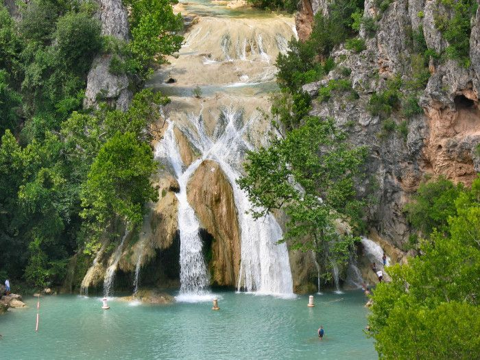 4.) Turner Falls- Davis, OK: Who doesn't love swimming near gorgeous waterfalls?  Plan on spending a bit more for this park,  as it will run you $12 per adult and $6 for children ages 6-12.
