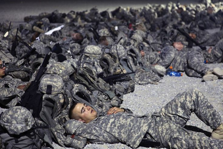 PEOPLE WAITING FOR SOMETHING TO HAPPEN -  U.S. soldiers waiting for a flight to Iraq from an airbase in Kuwait