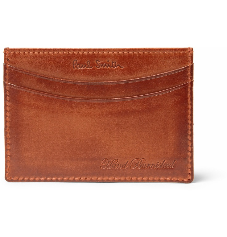 PAUL SMITH - BURNISHED LEATHER CARD HOLDER - €135.24    Hand burnished for a pre-aged look, this Paul Smith leather card holder has substance to back up its stylish appearance. Lightweight and built to last, its slim construction ensures that it doesn't ruin the line of your trousers.
