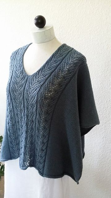 This garment was designed to be a cropped topper poncho with the option of wearing the lace across the shoulders, or turned and worn as a v-neck poncho. It is seamless with self finished edges.