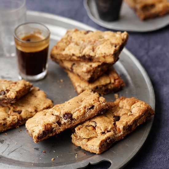 Chocolate-Almond Bars | Almonds and chocolate are a winning combination. For these crisp, chewy bars, Grace Parisi mixes roasted almonds, almond butter and chocolate chips with sugar and egg, then bakes them.