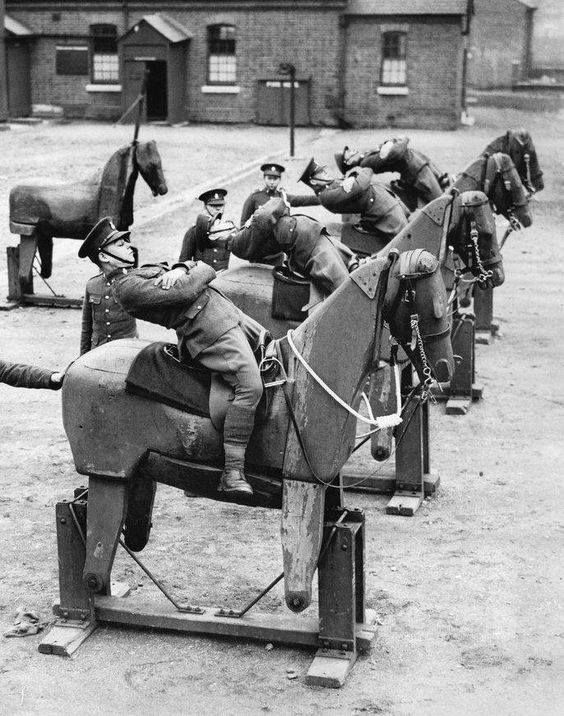 New recruits at the barracks of the 7th Queens Own Hussars a British cavalry outfit that dated to the 17th century learned balance on wooden horses. March 21 1935.