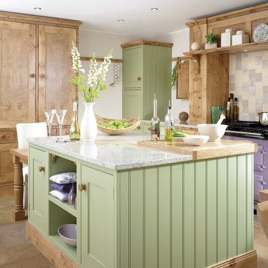 I like the use of the walnut and pale green hand painted units here which make it very homely