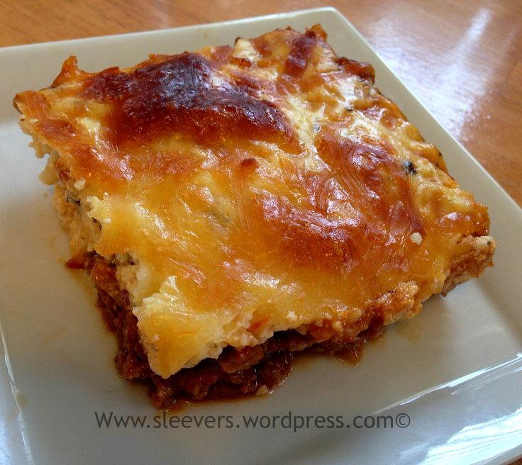 Low Carb High Protein Lasagna [1 lb ground beef with 2 c marinara, onions and seasonings for bottom layer, top layer is 8 oz ricotta or cottage cheese, 1 cup shredded mozzarella cheese, 1/2 cup grated Parmesan cheese, 2 large eggs and seasonings - would make a small casserole]