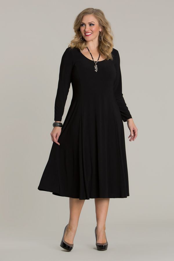 6711 Flip N Flare Dress - Create an evening look with by adding gorgeous diamante accessories and heels to this plus size dress or wear as a casual or work-wear dress with a simple necklace or bracelet. Features rounded-neck, long sleeves, flared hem and length to sit below the knee. This dress is available in-store and online.