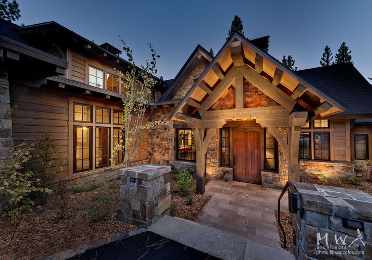 Martis Camp Entry Limestone Patio Heavy Timber Truss