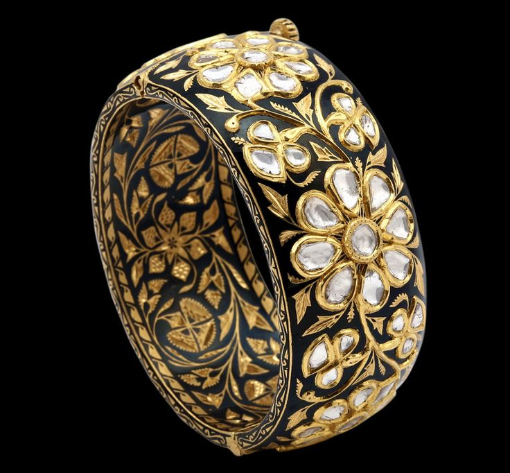 Unusual use of black enamel on this Sunita Shekhawat bangle in 22ct gold with rose-cut diamonds.