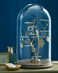 Heirloom Family Tree in a Glass Dome diy (using small personal objects as decorative elements on tree in addition to names)