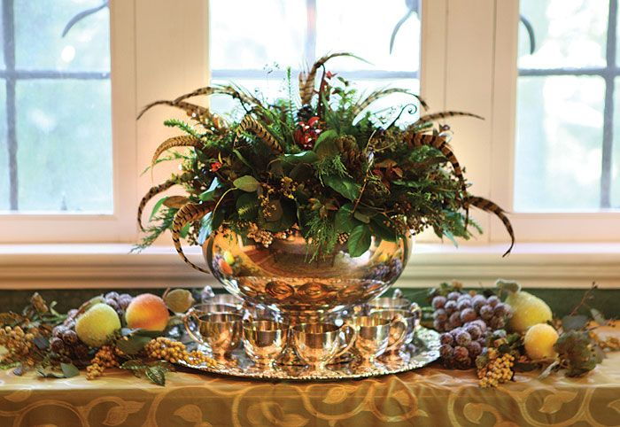 Gorgeous Feather Centerpiece in a Silver Punch Bowl surrounded by fruit.  By Petals Galore.  Stunning for Thanksgiving