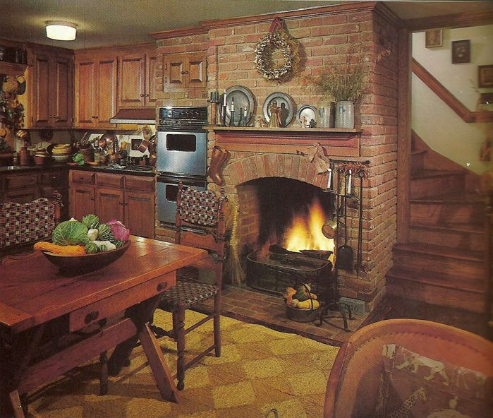 Love, love, love this kitchen, especially the fireplace and the staircase winding behind! <3