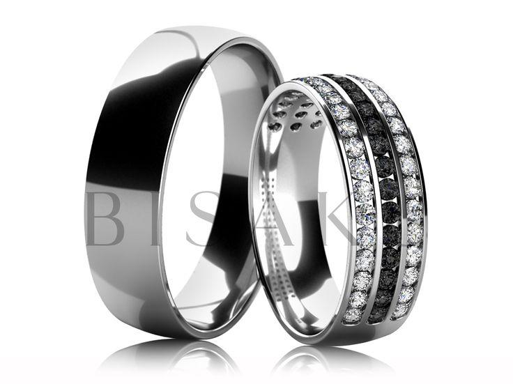 4676 Snubní prsteny z bílého zlata v lesklém provedení (vysoký lesk). Dámský prsten je do poloviny zdoben třemi řadami kamenů, z níž prostřední je tvořena černými kameny, které prstenu dodávají tajemný a originální vzhled. #bisaku #wedding #rings #engagement #svatba #snubni  #prsteny
