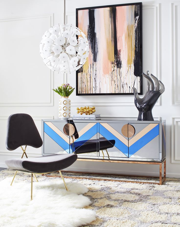 This Jonathan Adler corner of perfection hosts his Maxime Lounge Chair in Charcoal, Nouvelle Credenza, and Vienna Globe Chandelier. This colorful cross-section displays a nod to Neo-Memphis style and a wink of Modern American Glamour.