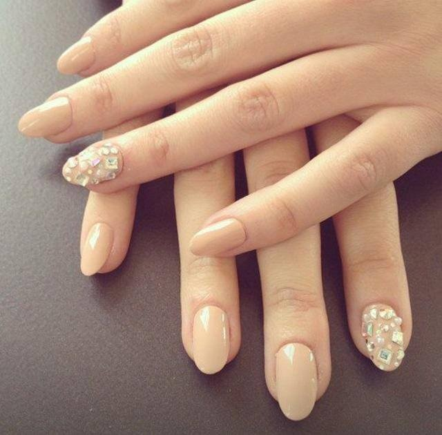 Jewel encrusted nude nails