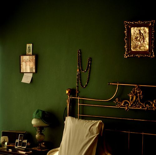 Interior colour: green and brass, bedroom with a luxurious feel