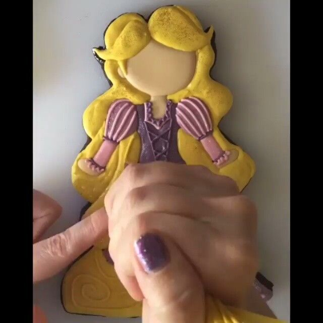 #Rapunzel, Rapunzel, let down that hair!!! Ooh my.. Absolutely love this cookie.. I'm a little bit obsessed with the hair... Cookie by @missdoughmestic #cookies #edibleart #royalicing #dessert #desserts #sugar #sugarcookies #amazing #disney #tutorial #video #disneyworld #food #yum #bake #homemade #baking #frosting #insta