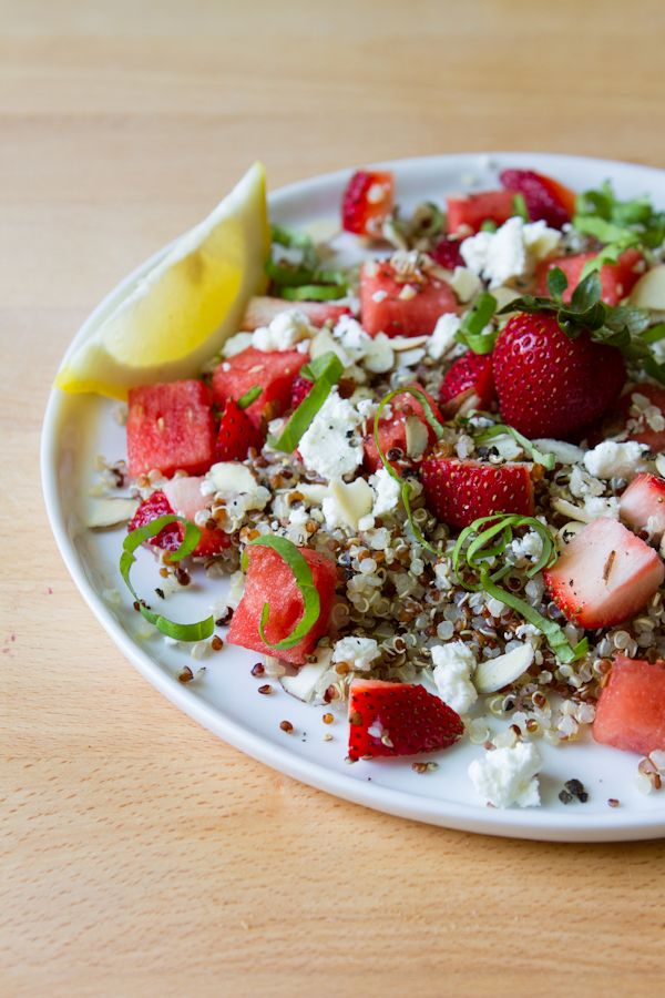 Watermelon Strawberry Basil Quinoa Salad 1 batch lemon shallot dressing 3 cupscooked quinoa 1 1/2 cups watermelon, 1/4-1/2-inch cubes 1 1/2 cups strawberries, hulled + chopped Goat cheese, crumbled Basil, thinly sliced Sliced Almonds Honey Lemon, strawberries, salt, pepper, to garnish