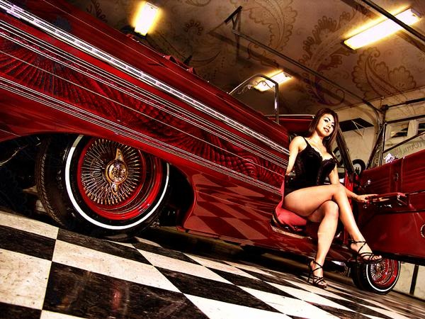 lowrider girl leaning over something