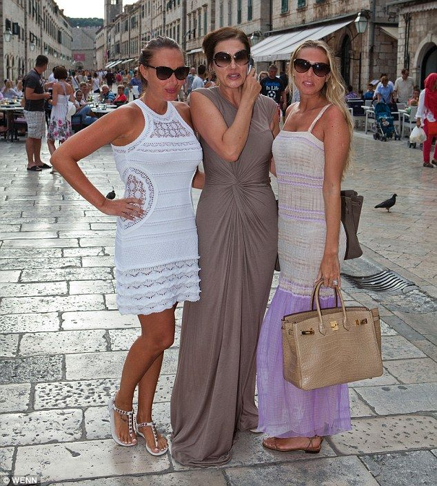 Strike a pose: Tamara and Petra Ecclestone are on holiday with their mother Slavica in her native Croatia