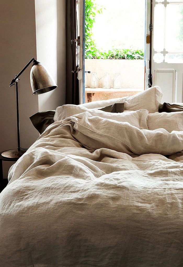 Beautiful french interior ideas and inspiration. Decorate your home like  parisian. Cozy bedroom with linen sheets.