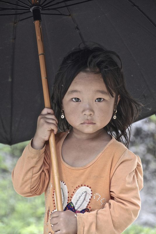 ˚A young girl of a White Tai ethnic village nearby Mai Chau in Vietnam