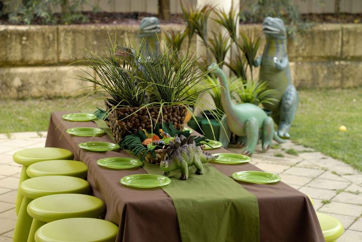 Cool centerpiece idea for a dinosaur themed birthday party!