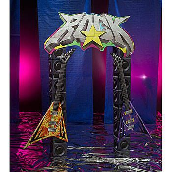 The Rock Star Arch features a large ROCK icon, two Flying V® guitars and stacked speakers. The cardboard rock arch measures 9 feet high x 5 feet 9 inches wide and is printed on one side.