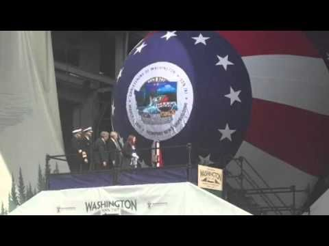 Elisabeth Mabus, the daughter of Navy Secretary Ray Mabus, christens the submarine USS Washington on Saturday, March 5, 2016 in Newport News.