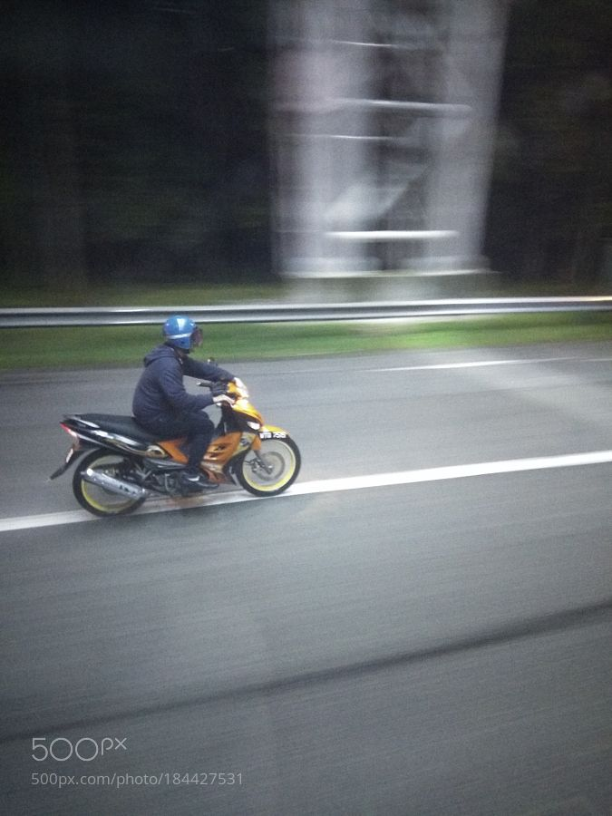 http://500px.com/photo/184427531 Driving in the rain by szirazabierowski -Pictures taken on the way from the airport at kuala lumpur. Tags: nightwindrainasiamotorcyclebikelanemalysia
