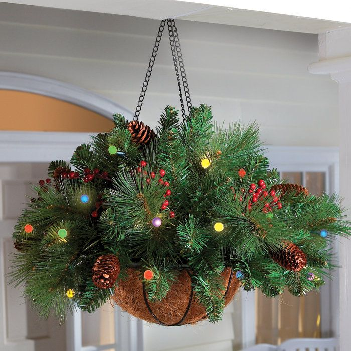 Grab hanging baskets now on summer clearance sales! Add a few springs of garland, some battery operated lights, and add some pine cones and holly for this wonderful porch decoration. No need to buy one, make on!Love it!