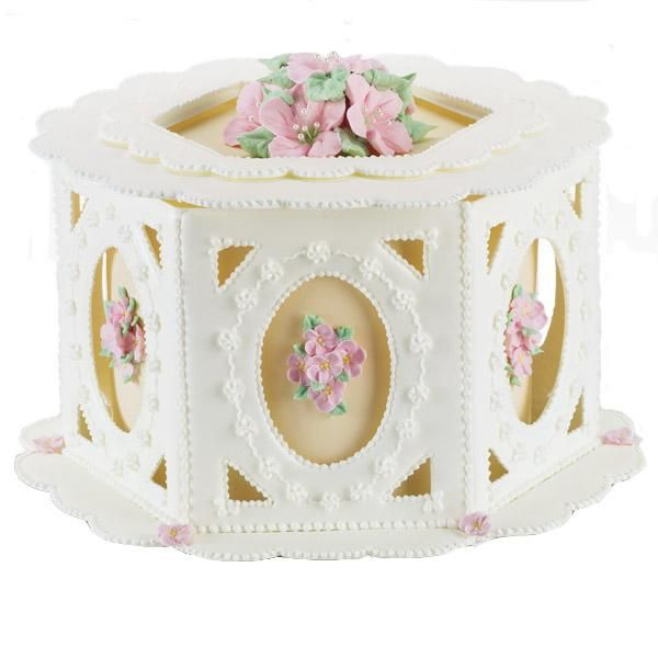 Nirvana Cameos Cake - A color flow framework draws the eye to botanical images created with royal icing. Use our patterns and piped-icing mortar to construct the gazebo-like overlay.
