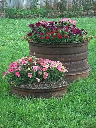 Tire rims as planters for a flower garden?  This is vintage Ozarks.
