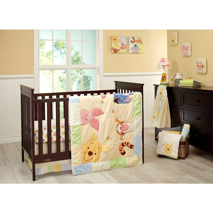 With 100% cotton fitted sheets, the Disney Baby Peeking Pooh 7-Piece Crib Set will help your little one sleep tight. One sheet features a fun print pattern and the other is in a solid sage color, so you can choose the one that suits your child's nursery best. The comforter depicts Pooh, Tigger, Eeyore and more friends from the Hundred Acre Wood playing peek-a-boo for a fun design your little one will love. Lovely wall hangings feature Pooh and several of his friends on pastel colors for a…