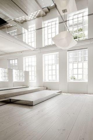 loft interior with large windows, platforms & mirrors