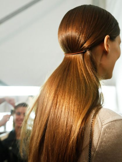 Supersleek hair (with a deep side part) at Michael Kors Spring 2013