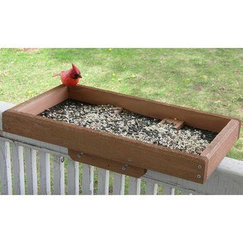 Deck / Post Tray Bird Feeder....I am thinking a tray might work for this by treating it against the weather, maybe drill a couple holes in it, and somehow post outside my window...Love to watch the birds feeding in the winter.