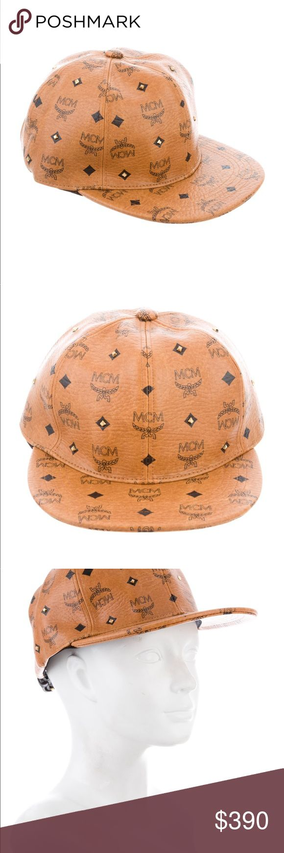 MCM hat leather Men's cognac and black Visetos leather MCM cap with gold-tone hardware, stud embellishments throughout and adjustable buckle strap at back. Designer size M. MCM Accessories Hats