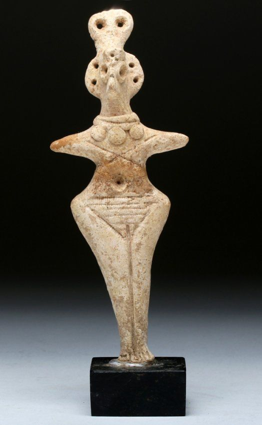 Syro Hittite clay figurine, 2750-1900 B.C. With arms extending outward, a bird like eyes, wear beaded necklace and elaborate crown, 14.9 cm high. Private collection