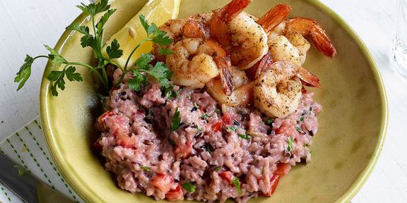 Risotto van paarse rijst en kokosroom met scampi